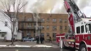 Rochester firefighters battle a blaze in an apartment building on Thurston Rd.