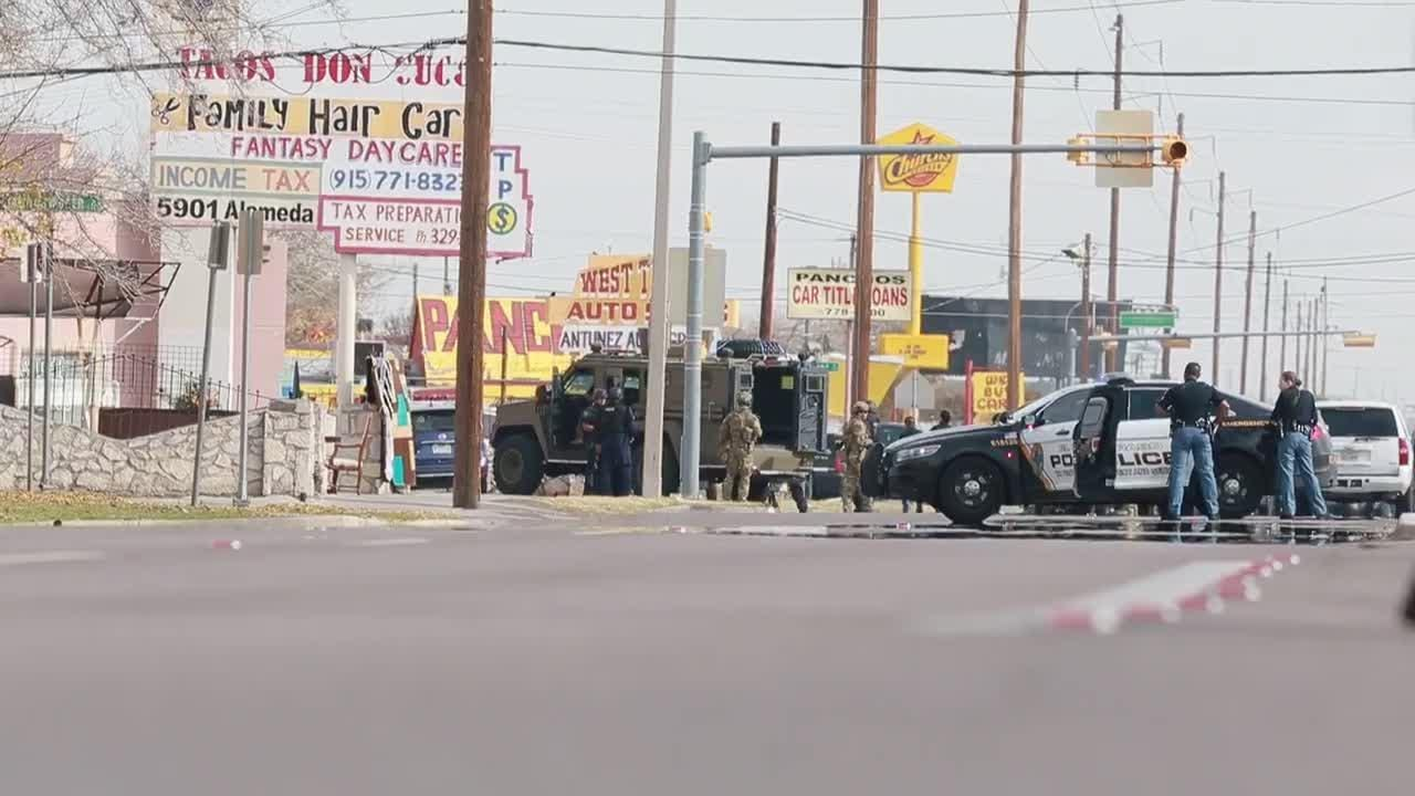 El Paso police Tuesday block off a neighborhood near Seville Drive and Sambrano Avenue as they searched for a suspect in the shooting of an officer.