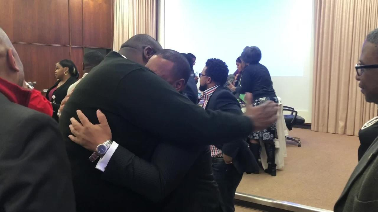 Friends and board members hugged Joris Ray after he was named interim superintendent of Shelby County Schools.