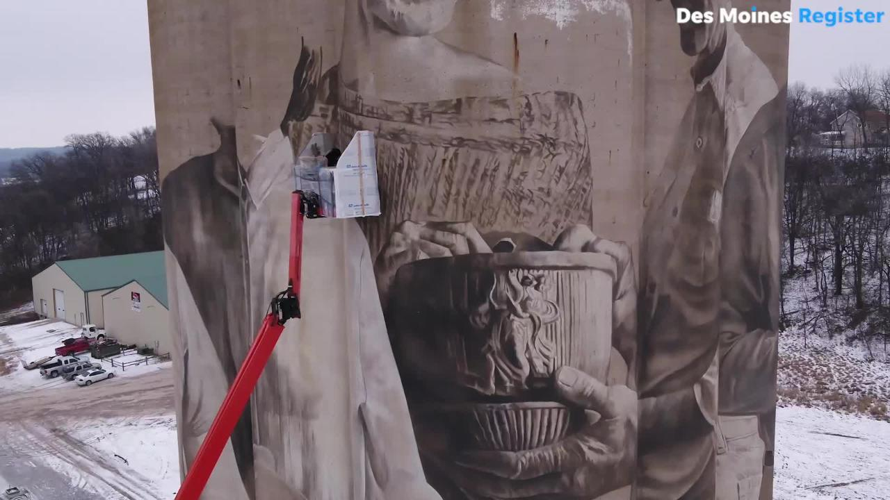 Using a 110-foot silo as his canvas, Australian artist creates Iowa's largest mural