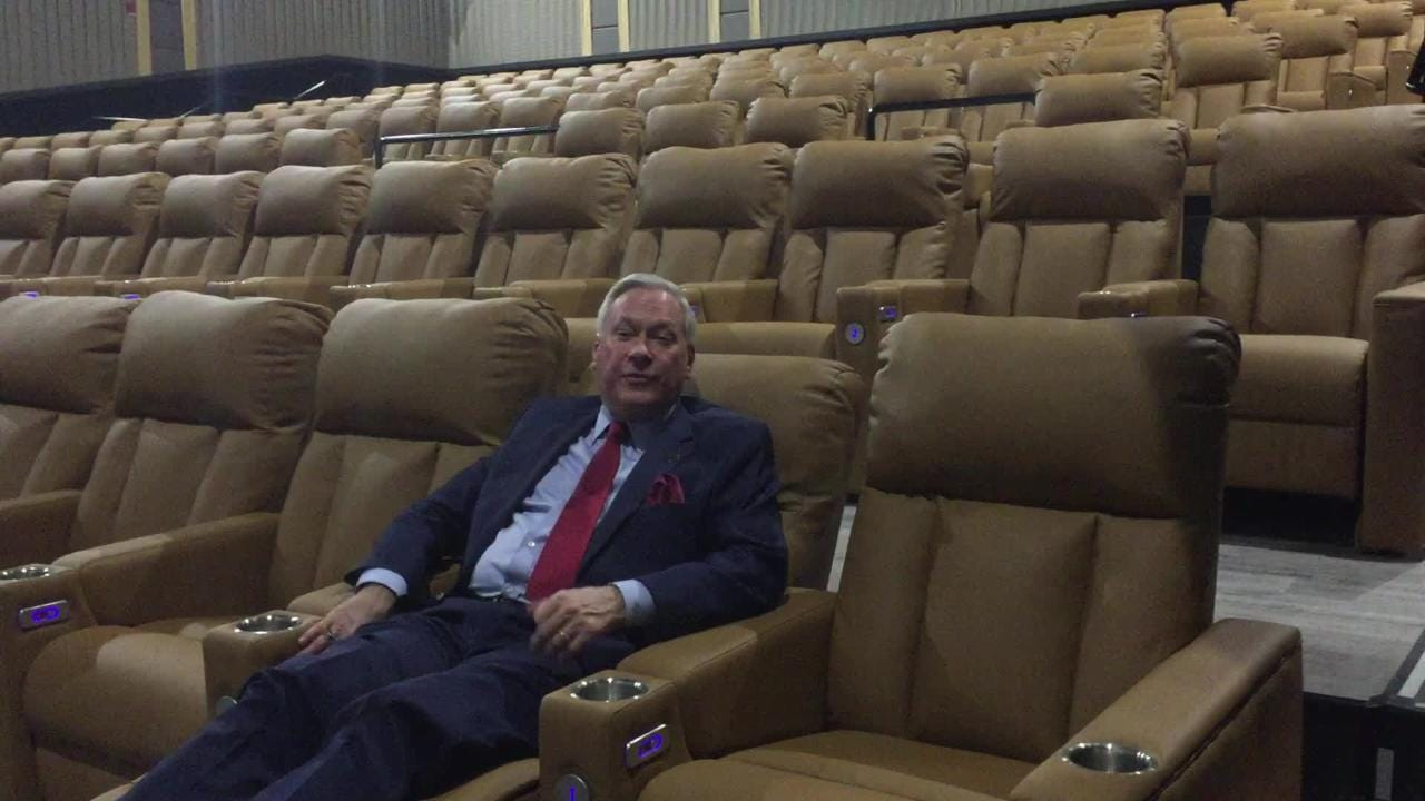 Emagine Entertainment CEO Paul Glantz shows off some luxury features of an EMAX theater at the new Emagine Hartland movie theater.