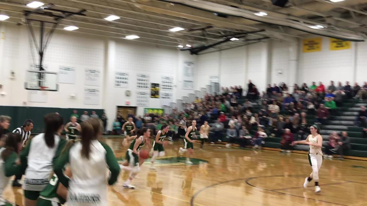 Pascack Valley senior Brianna Smith draws a charge as Ramapo's Madison Schiller drives for the potential tying layup in final seconds. PV won, 53-49.