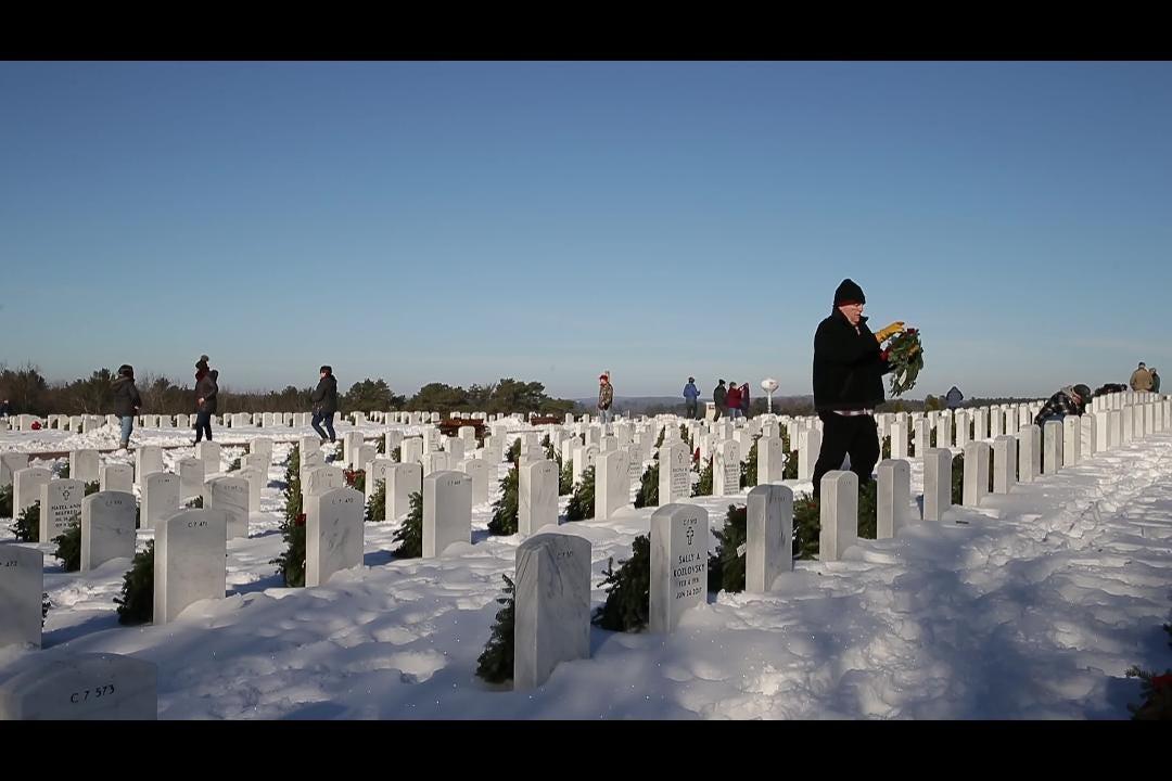 Volunteers take part in Wreaths Across America at King, Wis.