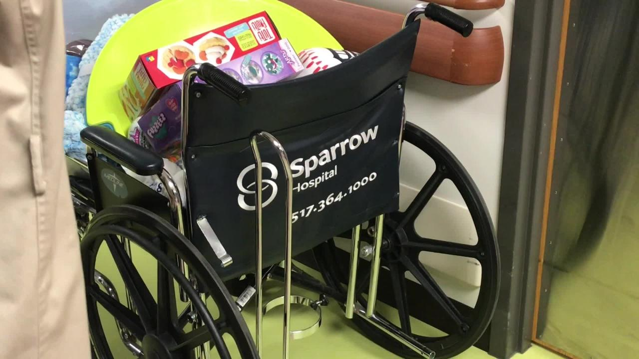 Lansing Police Department and Lansing Fire Department delivered gifts to sick and injured children at Sparrow Hospital on Dec. 19, 2018.