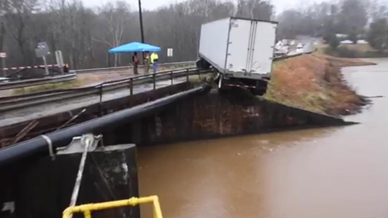 Tractor trailer across bridge driver realized he was overweight and tried to back up, backed up over guardrail, said Trooper Joe Hovis of the South Carolina Highway Patrol.