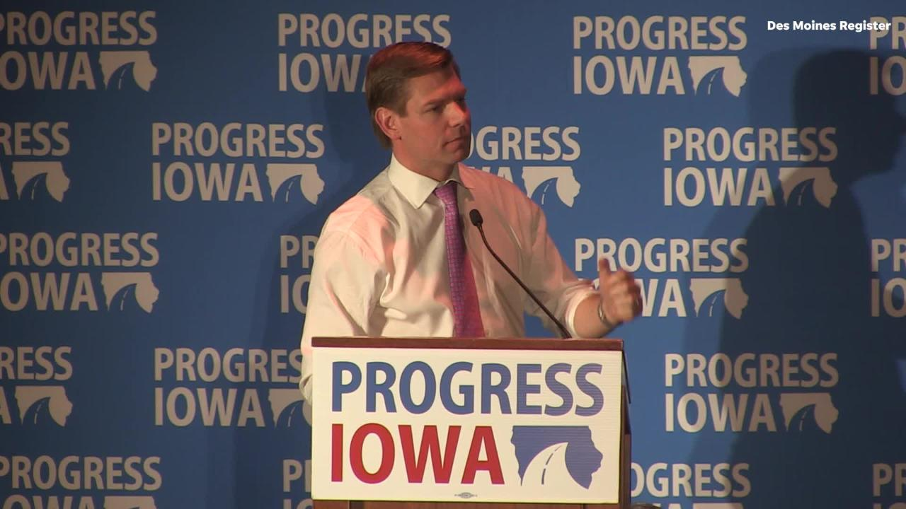 U.S. Rep. and Iowa native Eric Swalwell speaks during Progress Iowa's Holiday Party.