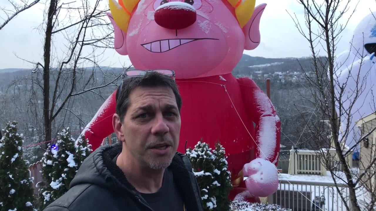 Bloomingdale Man creates a 30 foot blow up Heat Miser for his yard