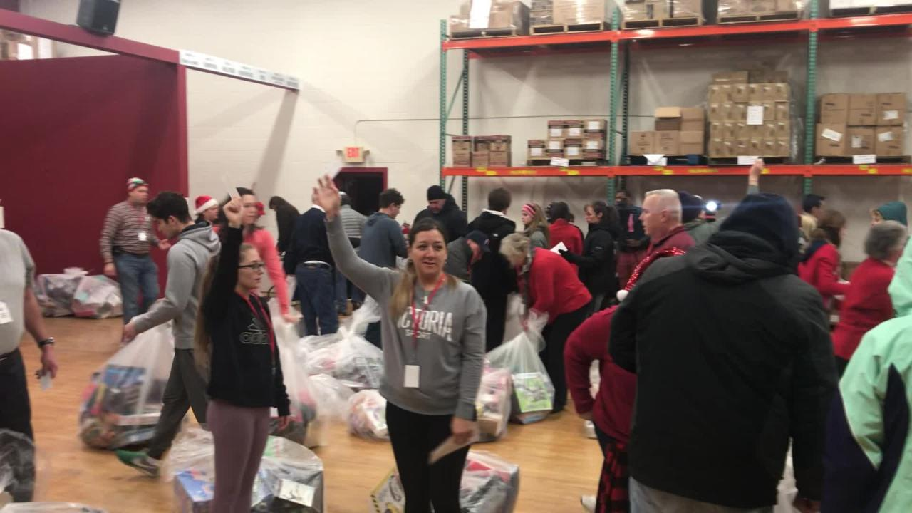 Hundreds of volunteers showed up as early as 8 p.m. on Christmas Eve to volunteer to deliver gifts on Christmas morning.