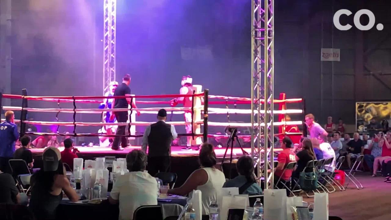 Bryan Brown from Fort Collins Police Services and Shane Mendoza from Thornton fire face off in the annual Guns vs. Hoses boxing match Sept. 15.
