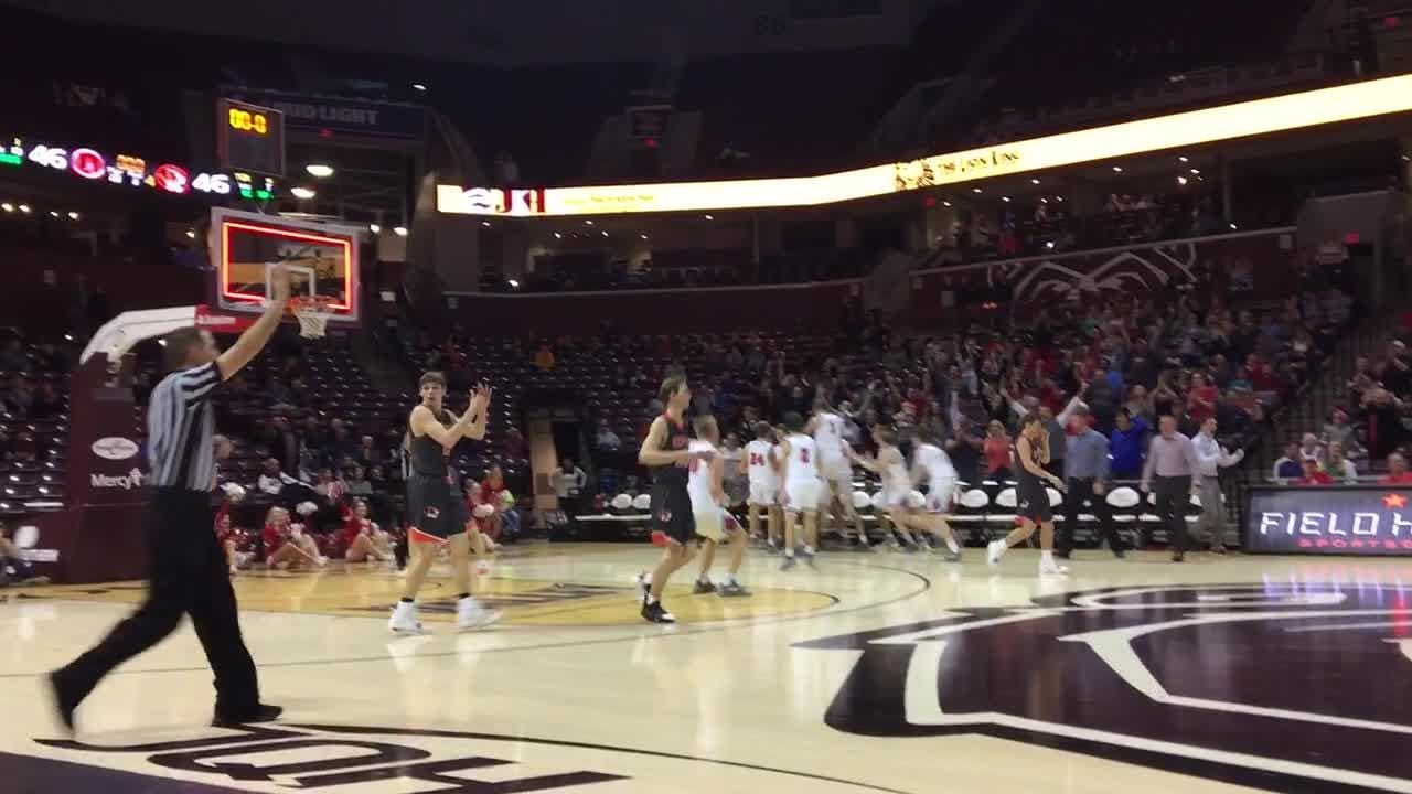 Ozark's Parker Ramsdell hits a shot with one second remaining to advance Ozark to the Gold Division championship.