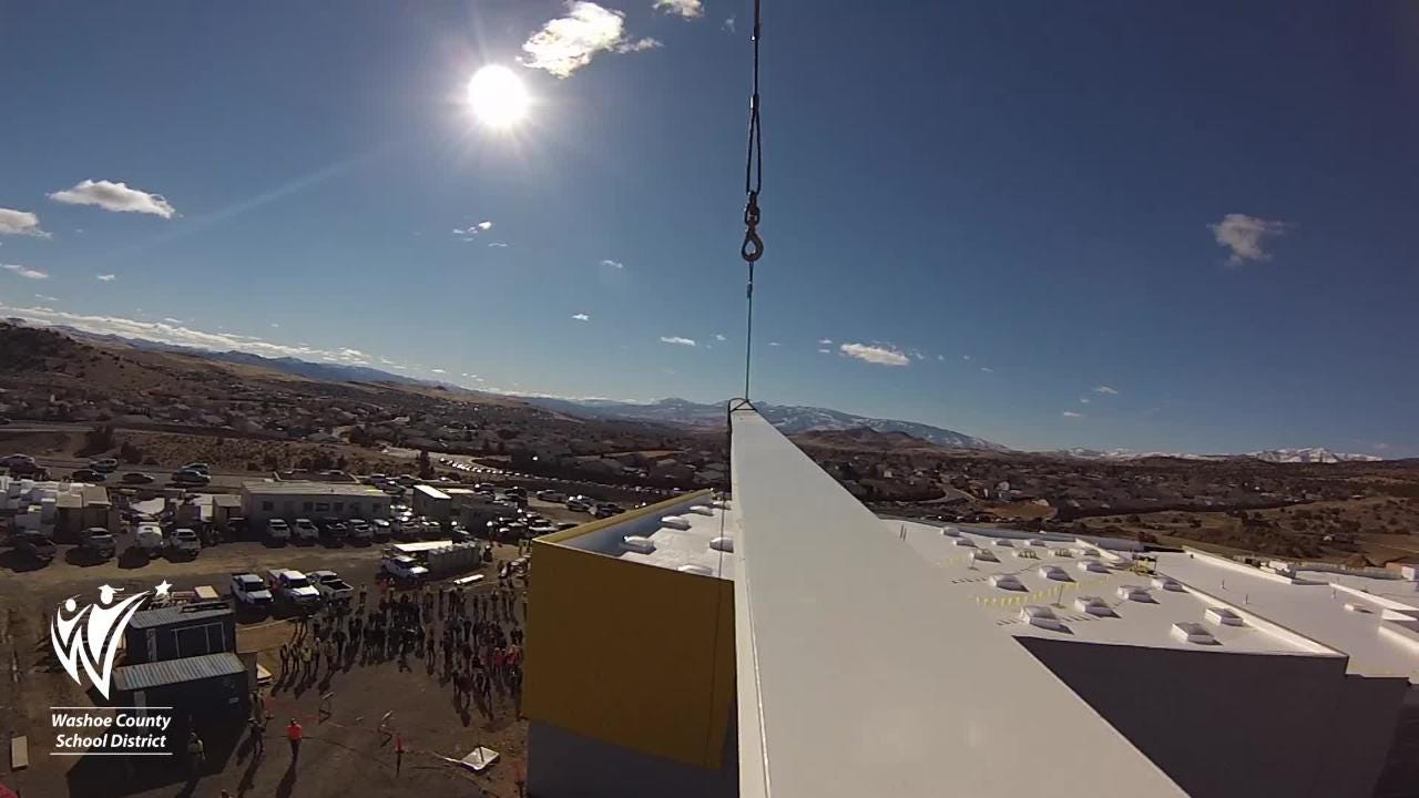 Watch as this steel beam is placed atop of the new Desert Skies Middle School in Sun Valley.