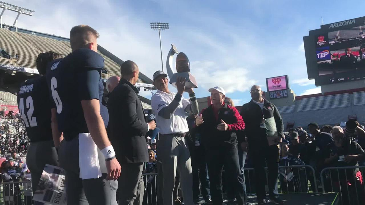 Nevada coach Jay Norvell, along with captains Ty Gangi, Malik Reed, and Wes Farnsworth, celebrate their Arizona Bowl win on Saturday.
