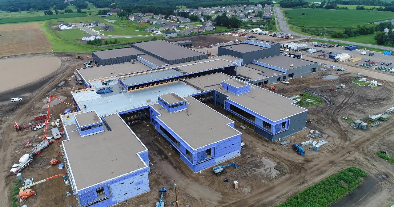 Video of Sartell High School as of July 2018. Now, fields are up and work has turned to inside.