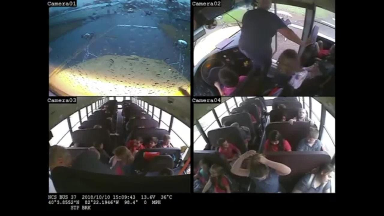 The video of a Newark unmarked police cruiser passing a bus has spurred an investigation.