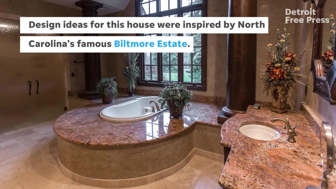 Super custom house by a luxury builder for himself has five acres surrounded by a decorative iron fence, set into the woods of Stony Creek Metropark.