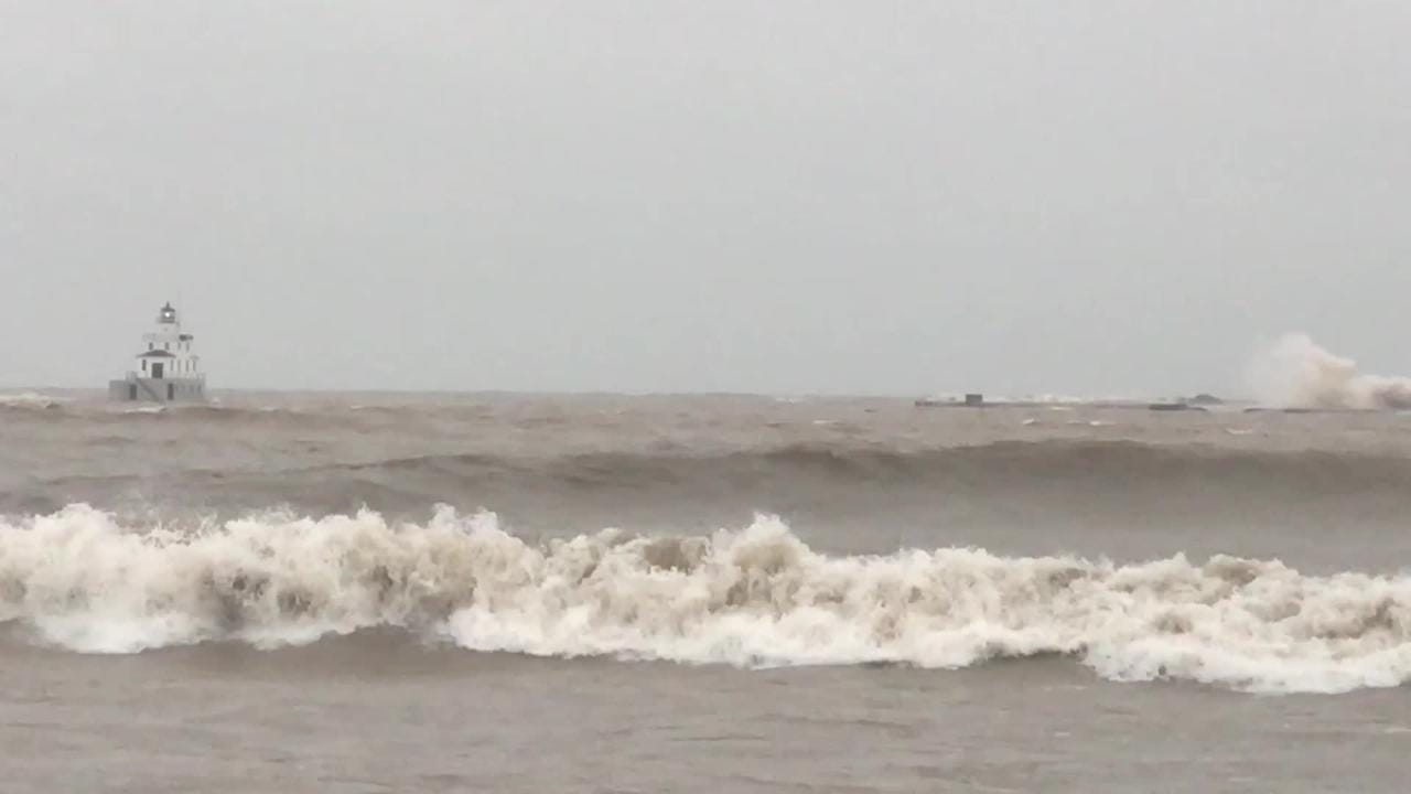 High waves such as these swept away the South Pier Light Navigational Beacon on Lake Michigan near the Manitowoc lighthouse Jan. 7.