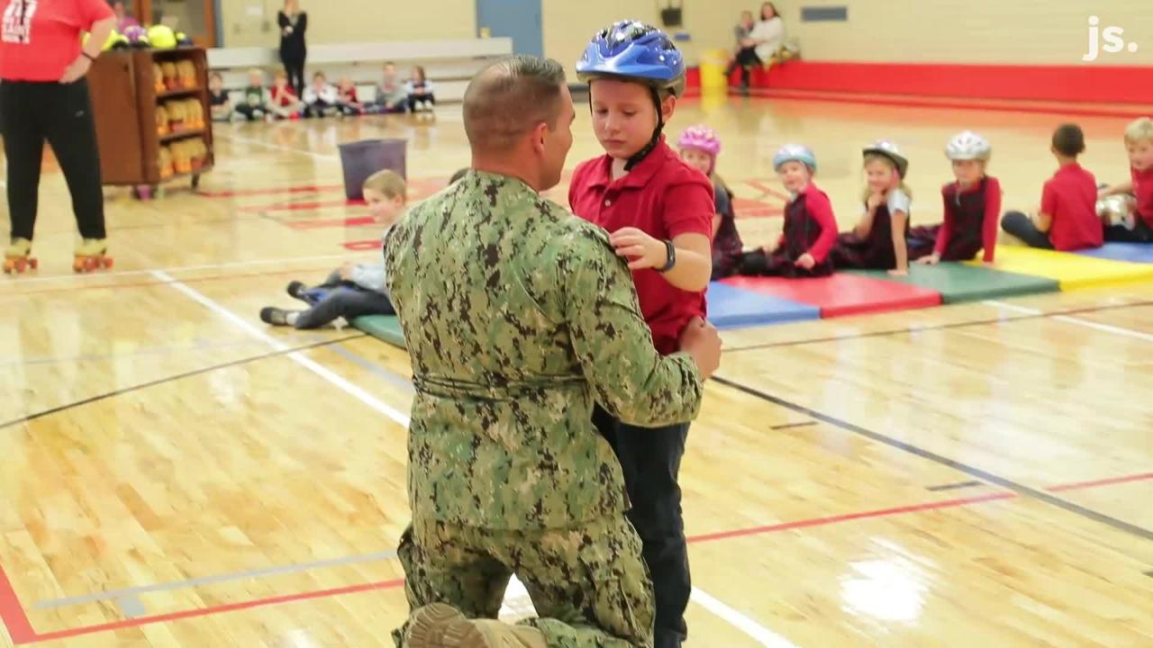 Navy Lt. Cmdr. Jon-Andrew Anderson-Ingebrigtsen surprised his son, Ethan Anderson, 7, at St. Monica Catholic School after a 20-month deployment.