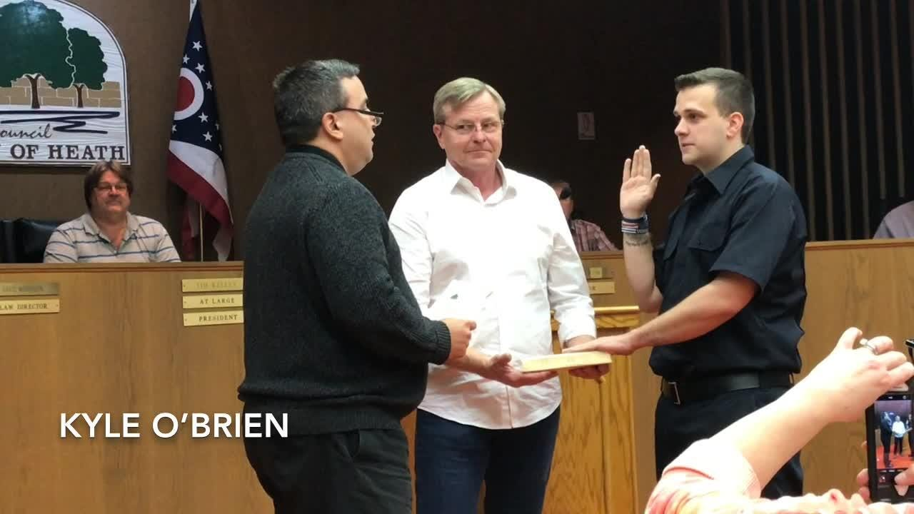 Heath Mayor Mark Johns swore in 3 new firefighters/paramedics at Monday's city council meeting.