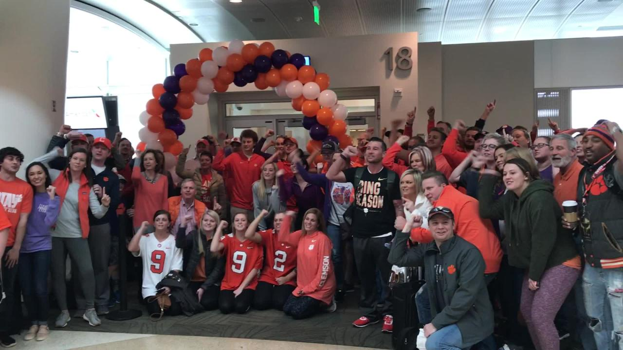 Clemson Tigers fans cheer for the team at San Jose International Airport before their flight back to Greenville.