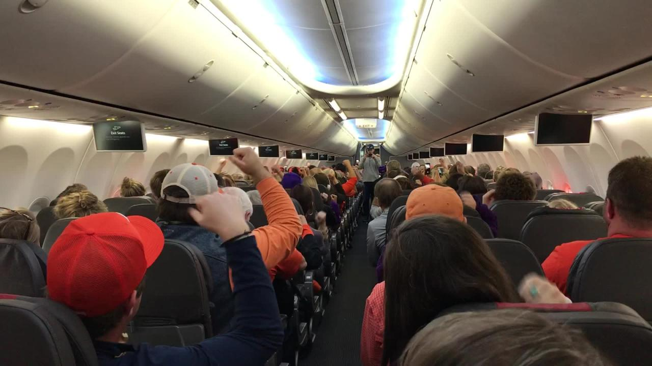 Clemson Tiger fans cheer on the plane ride back to GSP airport.