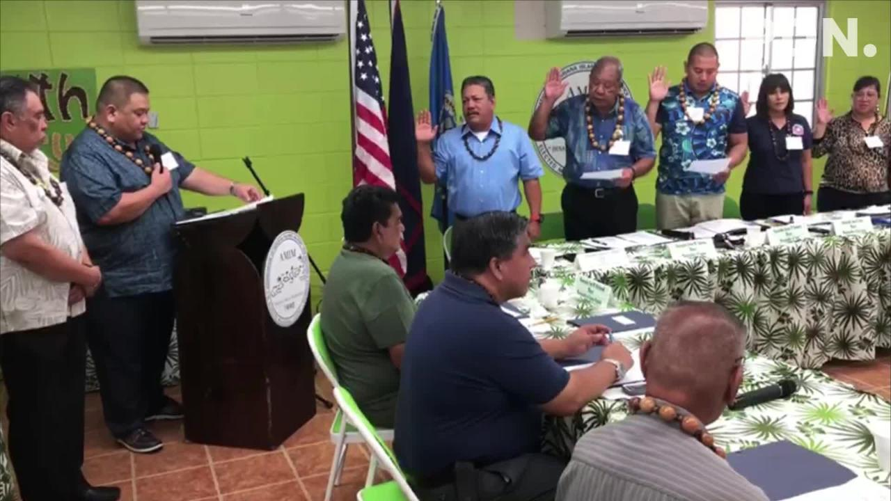 Outgoing Tinian Mayor Joey Patrick San Nicolas administers the oath of office to the new officers of the Association of Mariana Islands' Mayors and Vice Mayors Wednesday morning in Agat.