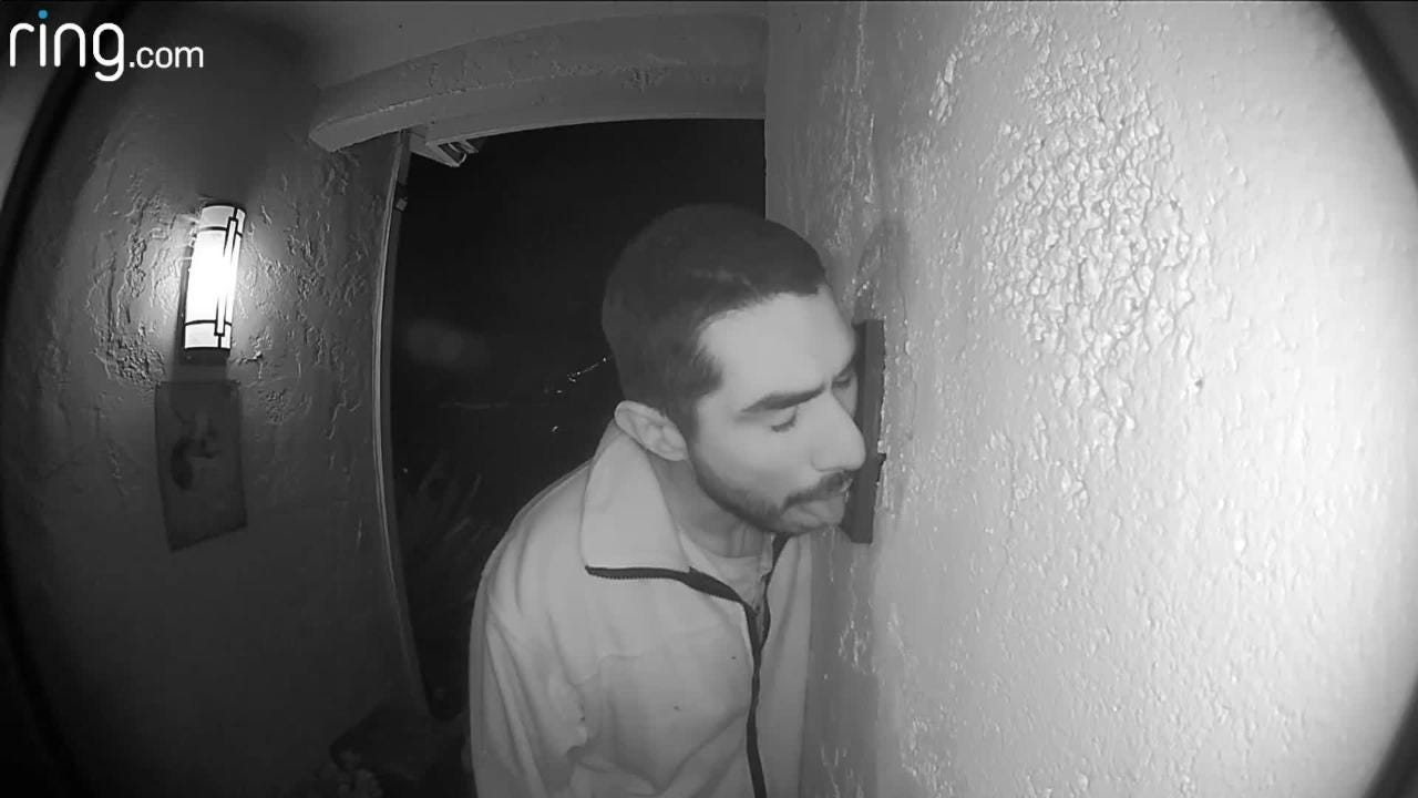 A man, whom Salinas police have identified as Roberto Daniel Arroyo, 33, approaches an intercom doorbell, which he proceeds to thoroughly lick.