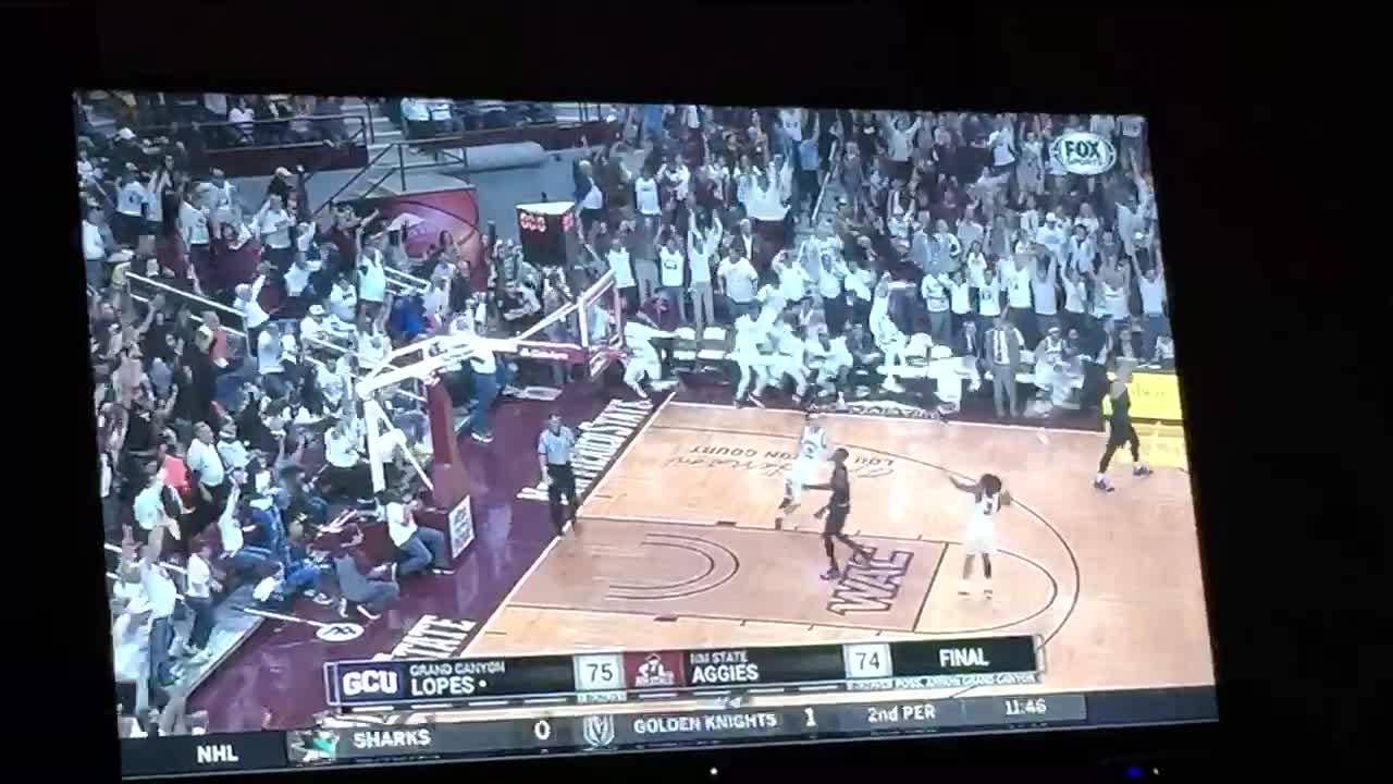 Johnny McCants buries a half-court shot at the buzzer