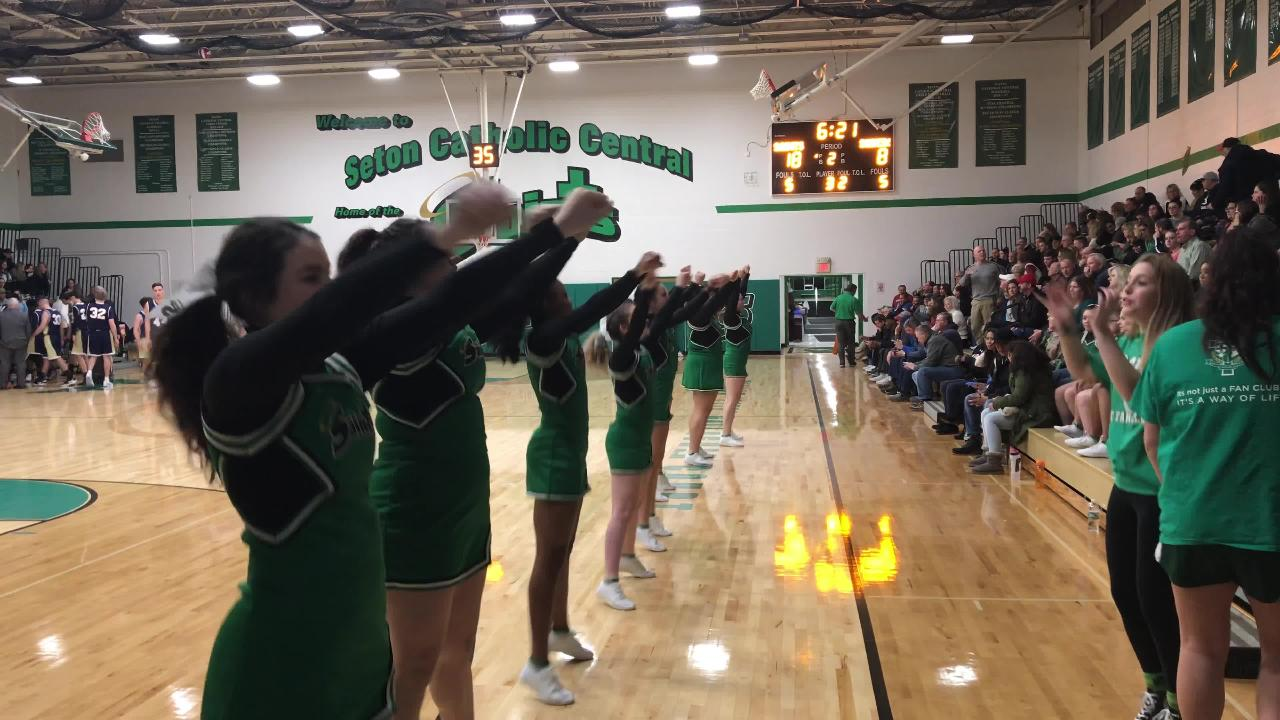 Seton Catholic Central cheerleaders perform during a timeout.