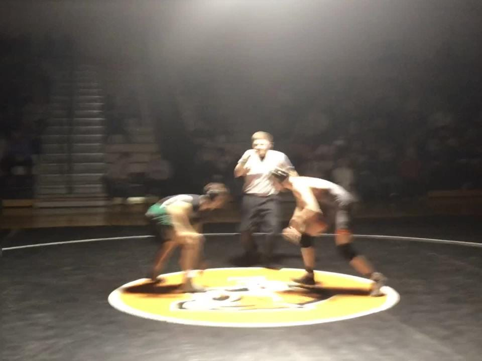 Union-Endicott's Colby Bendick and Vestal's Peter Sacco begin their 120-pound match at U-E.