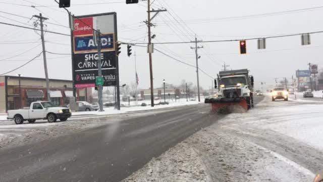 Hamilton County road crews clearing Colerain Avenue near Northgate Mall on Saturday, Jan 12.