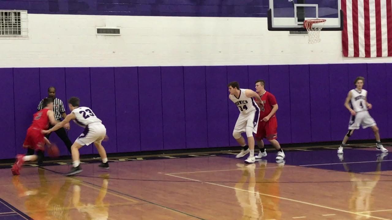 Chenango Valley's Marcus Hanyon receives a pass from Nate Klein and hits during the Warriors' STAC game at Norwich.