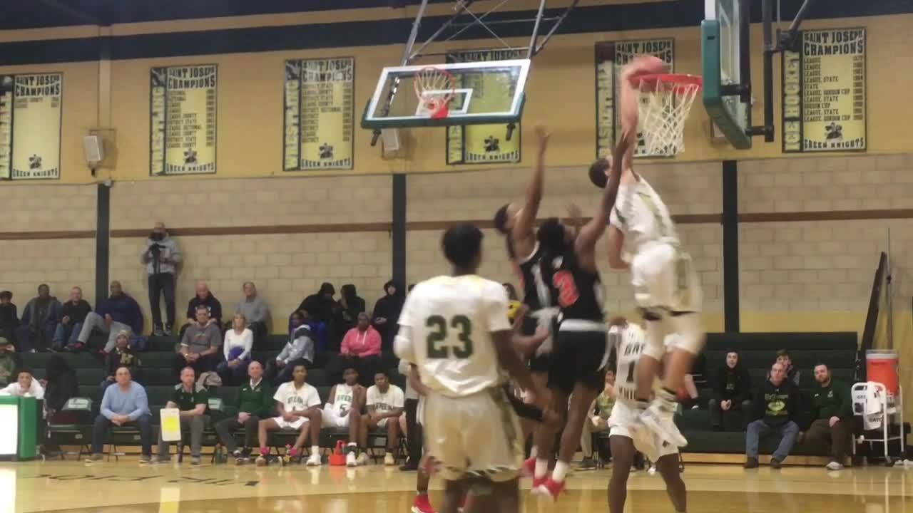 Chris Manon punctuates St. Joseph boys basketball win over Thurgood Marshall with an emphatic dunk at the Public Vs. Private Showcase.