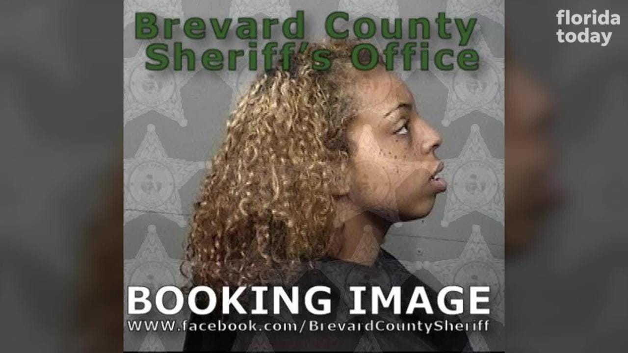 A woman was charged with filming an assault on her roommate in Palm Bay.