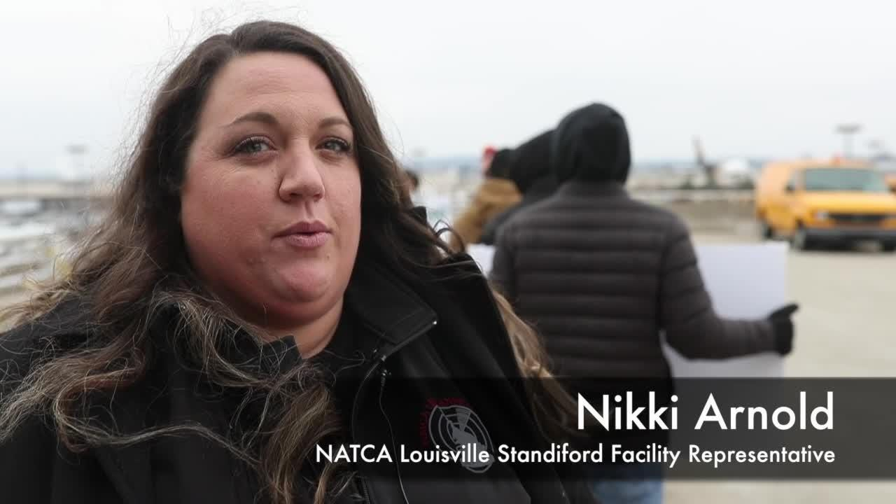 The ongoing government shutdown was protested by FAA employees at the Louisville airport on Tuesday. Many have just missed their first paychecks.