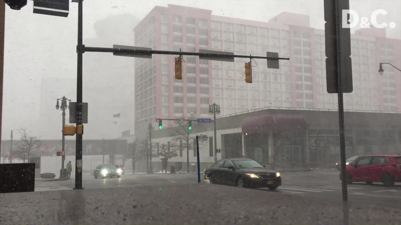 Snow squall blasts through downtown Rochester