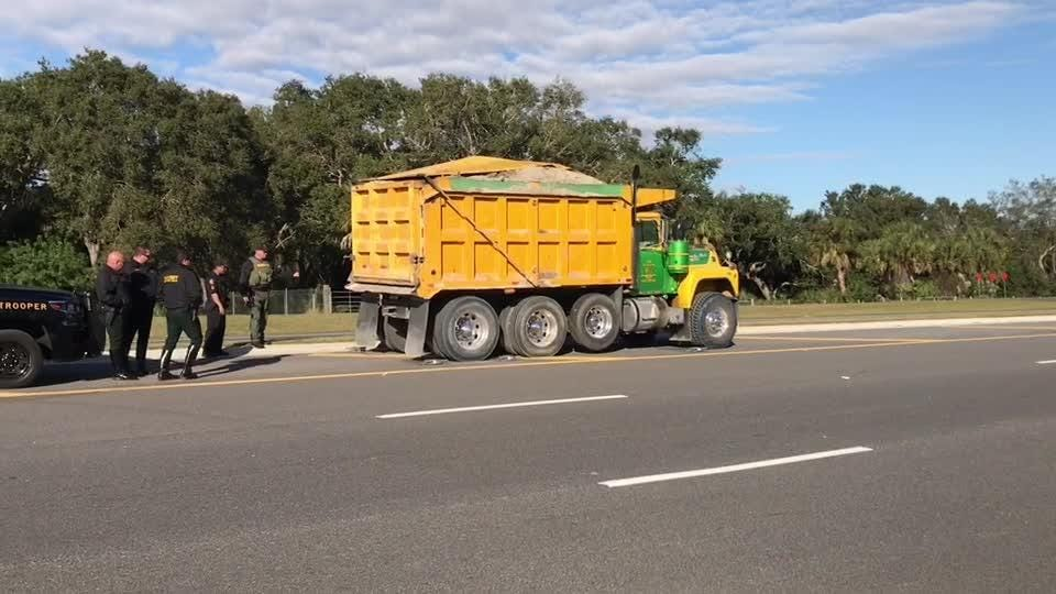 State and local authorities stopped several dump trucks Thursday hauling dirt to the Ellis Road interchange project.