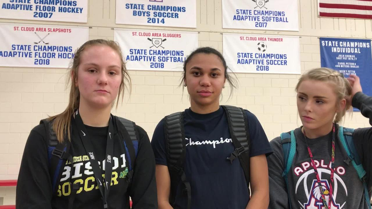 St. Cloud Apollo girls basketball players (from left) Ashley Koepp, Lariah Washington and Kaleigh Schuck talk about the Eagles' 79-32 win over ROCORI.
