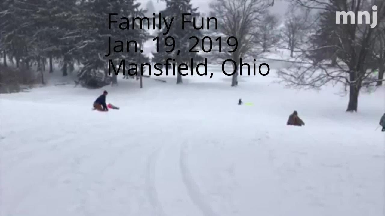 Families enjoyed some good, old-fashioned fun sledding at Liberty Park hill in Mansfield Saturday during the snowstorm.