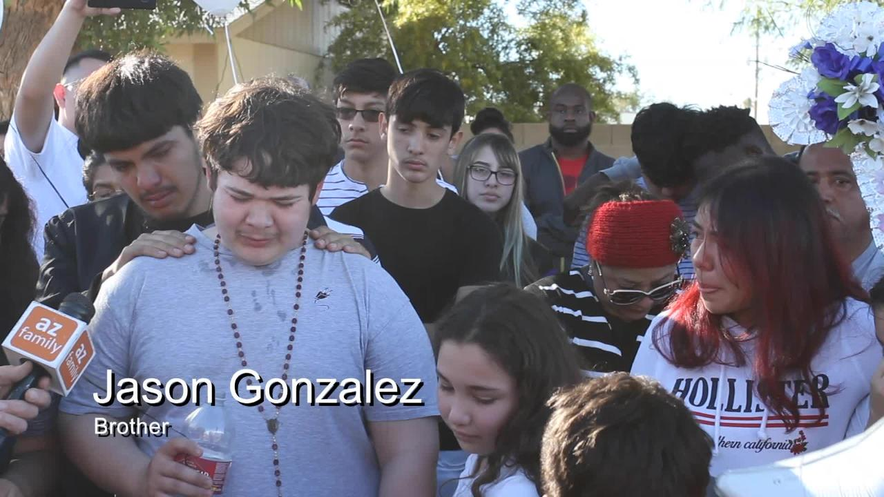Hundreds of people walk through the neighborhood where 14-year-old Antonio Arce was shot by a Tempe police officer earlier this week.