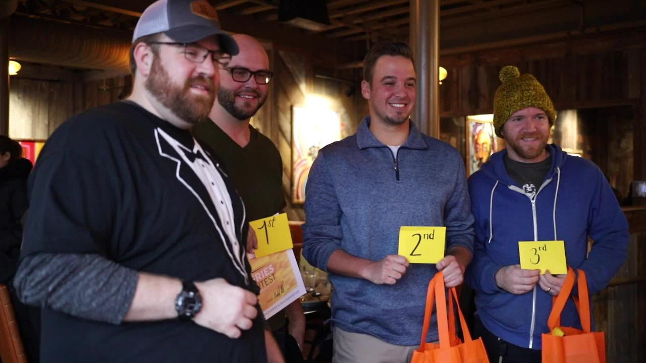 Contestants stuff their mouths with HopCat's fries to see who can eat the most.