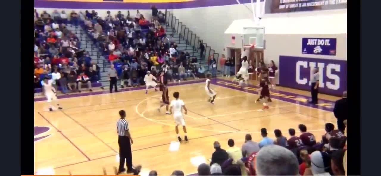 Columbia's Dontavius throws down an alley oop against Spring Hill on Saturday.