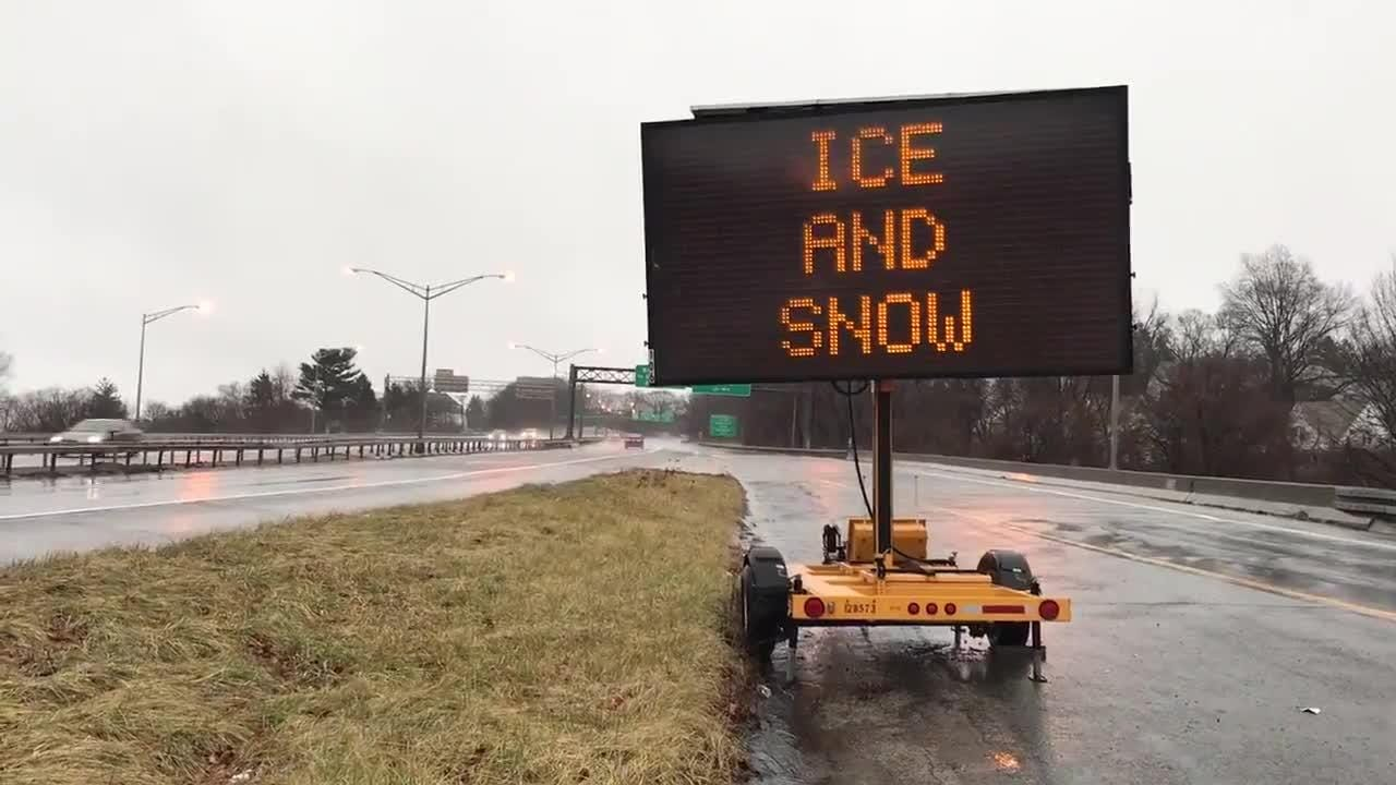 "Rainy wet conditions on the Cross County Parkway in Yonkers and a billboard reminder for ""ice and snow, take it slow."""