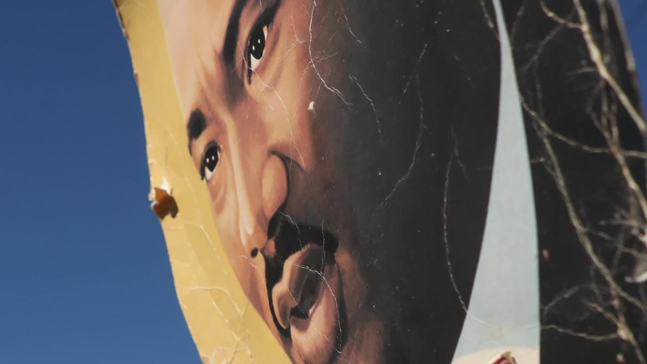 The story behind the sign that has been seen in the Martin Luther King Jr. commemorative march for more than 30 years.
