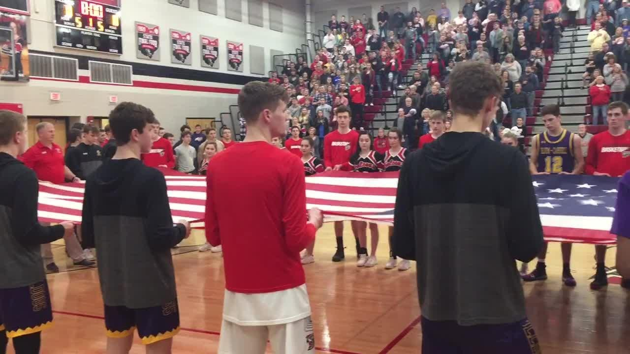 Nice touch by the Fairfield Union and Bloom-Carroll boys basketball teams and cheerleaders holding the flag on Military Appreciation Night.