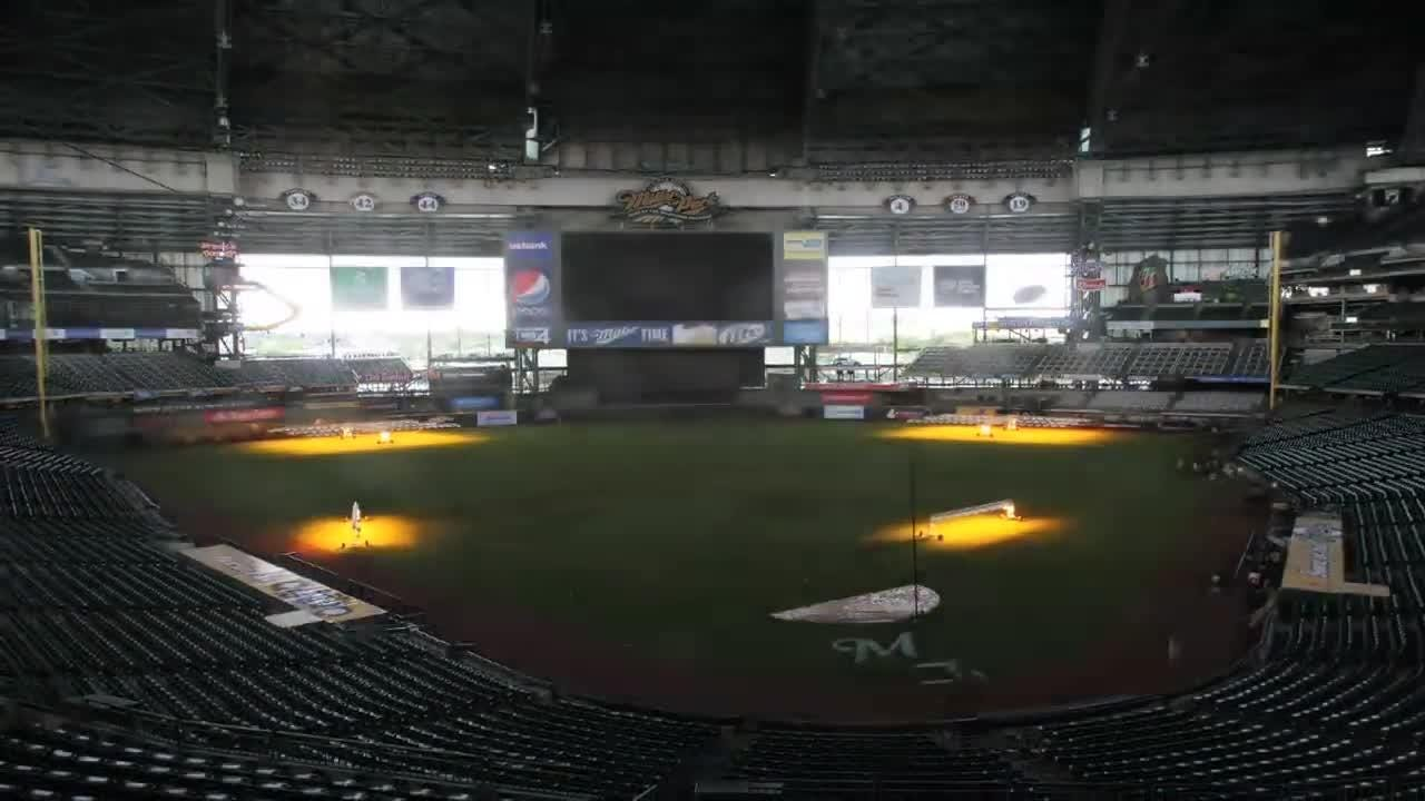 Miller Park grounds crew members work on converting the baseball field into a soccer pitch for a match between Chivas Guadalajara and Swansea City.