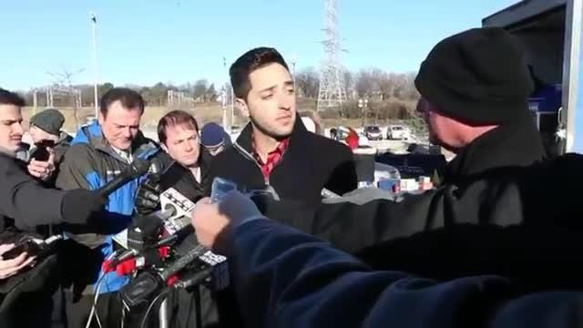 Milwaukee Brewers outfielder Ryan Braun greets donors at a charity food drive outside Miller Park.