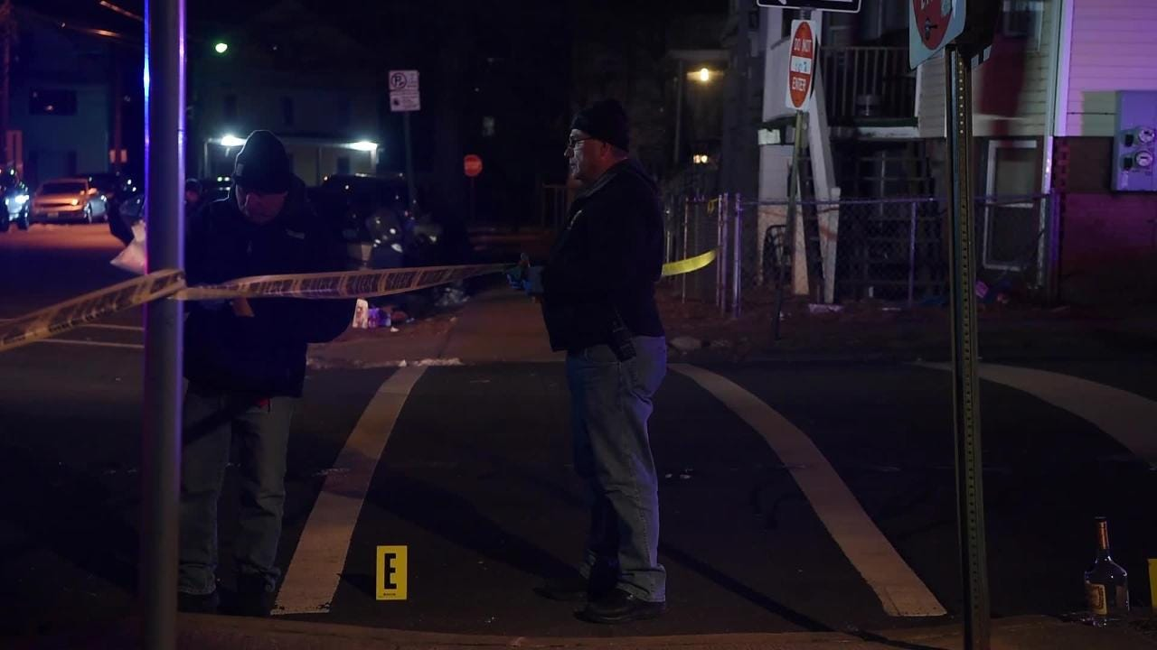 Members of the Paterson Police Department process the scene of a shooting at the intersection of N 10 St. and Temple St. on  January 22, 2019.