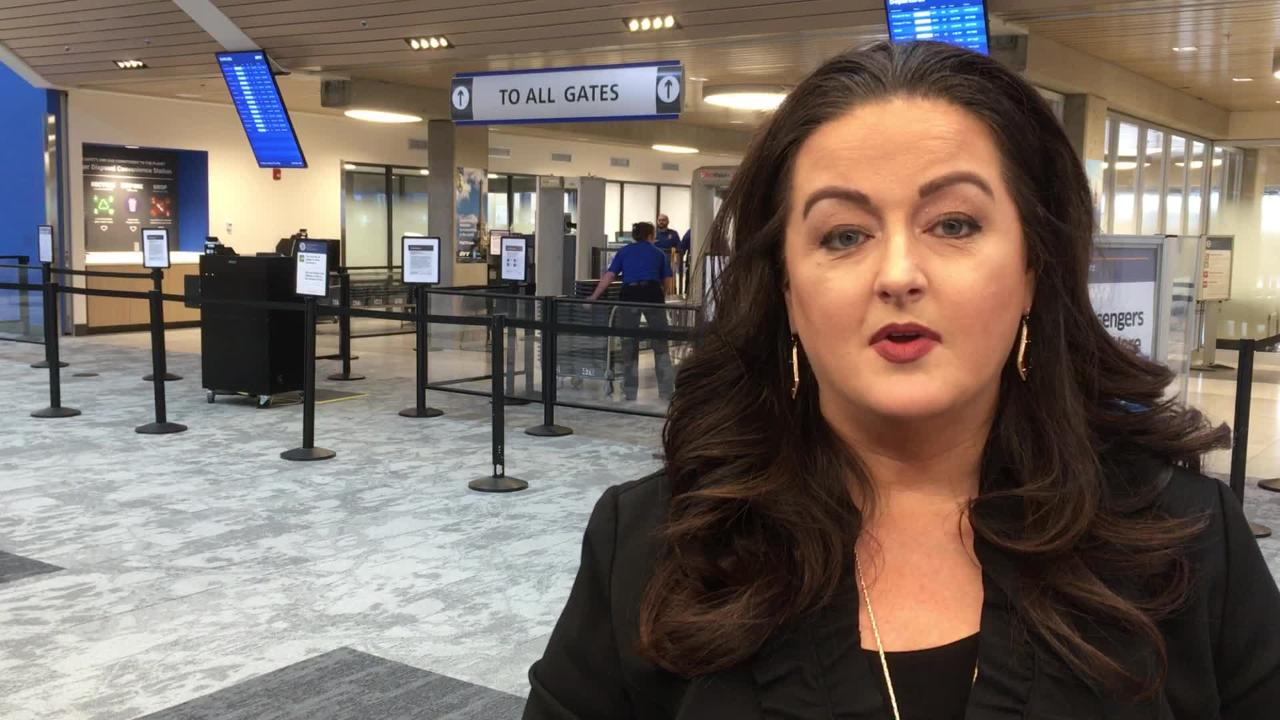Erika Taylor explains her meal train to help federal workers at Evansville Regional Airport during the government shutdown.