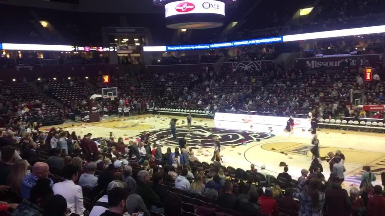 """Missouri State fans toss teddy bears on court during """"Share the Bear"""" event at halftime during Bears game against Loyola on Jan. 23, 2019."""