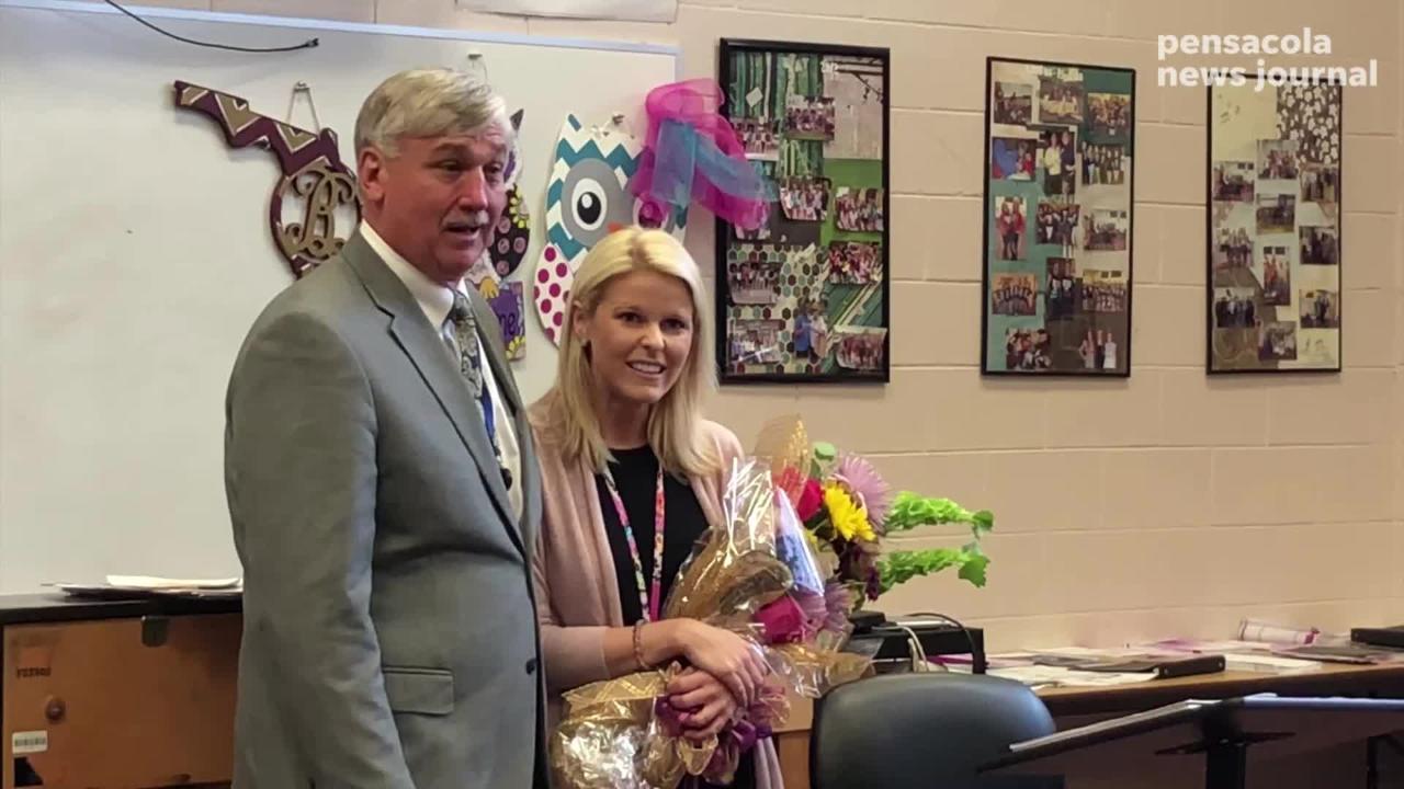 Watch as Santa Rosa County Superintendent Tim Wyrosdick surprised Navarre High School chorus teacher Caroline Buechner as Teacher of the Year.